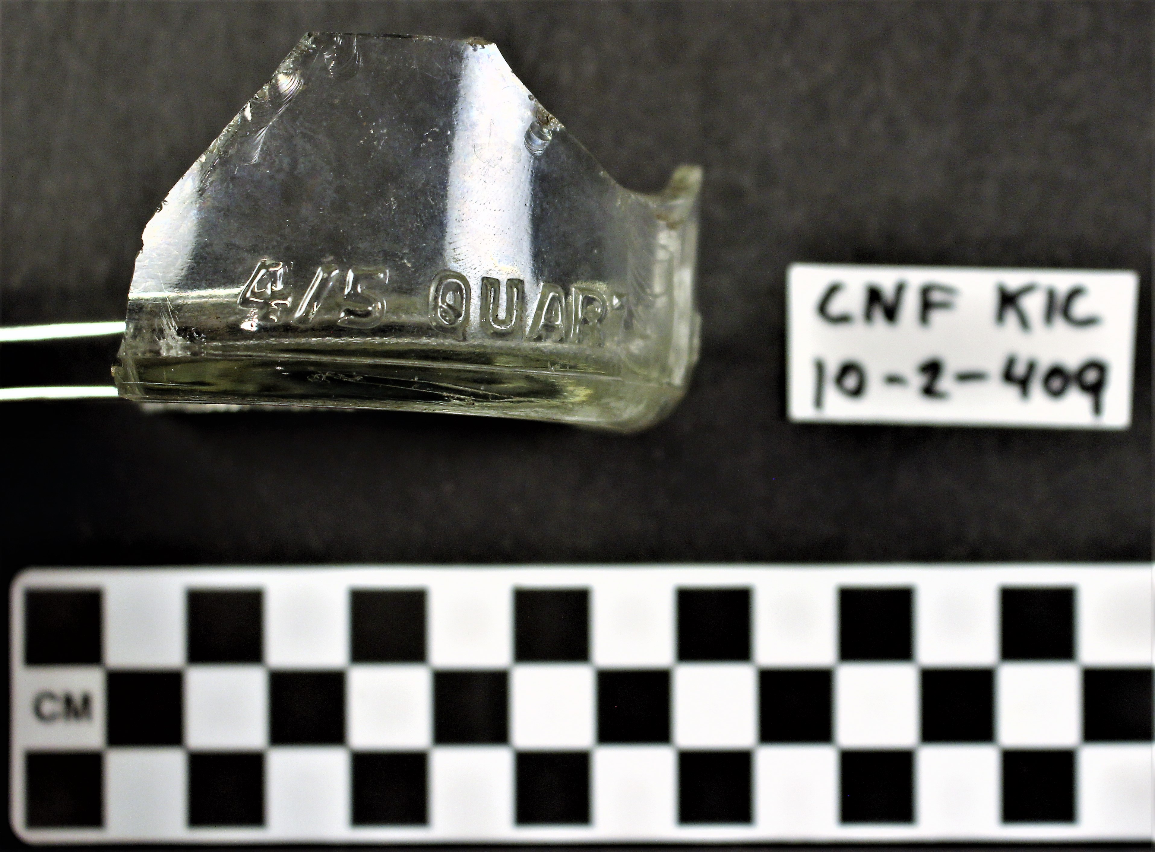colorless glass bottle fragment