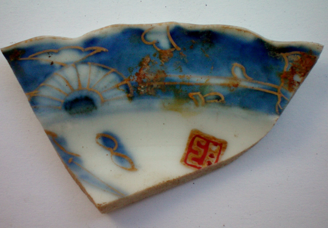 Fragment of hand-painted porcelain saucer